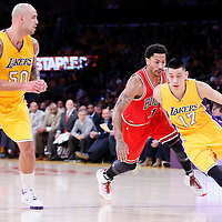 29 January 2015: Los Angeles Lakers guard Jeremy Lin (17) drives past Chicago Bulls guard Derrick Rose (1) next to Los Angeles Lakers center Robert Sacre (50) during the Los Angeles Lakers 123-118 2OT victory over the Chicago Bulls, at the Staples Center, Los Angeles, California, USA.