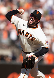 Oct 3, 2021; San Francisco, California, USA; San Francisco Giants pitcher Dominic Leone (52) delivers a pitch against the San Diego Padres during the ninth inning at Oracle Park. Mandatory Credit: D. Ross Cameron-USA TODAY Sports