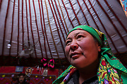 Kazakh woman in ger<br /> Autumn grazing ground<br /> Altai Mountains<br /> Bayan Olgii Province<br /> Western Mongolia