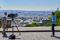 Paris , France - April 26 , 2020 :  Journalists on outdoors set  in Montmartre during the  lock down coronavirus covid-19 quarantine