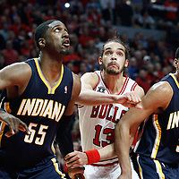 16 April 2011: Chicago Bulls center Joakim Noah (13) vies for the rebound with Indiana Pacers center Roy Hibbert (55) and Indiana Pacers small forward Danny Granger (33) during the Chicago Bulls 104-99 victory over the Indiana Pacers, during the game 1 of the Eastern Conference first round at the United Center, Chicago, Illinois, USA.