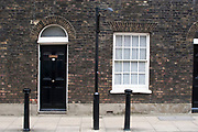 Front door of a Georgian house in London. Showing various eras of architecture. Londoner's homes.