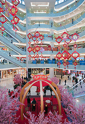 Interior view of modern large shopping mall in Wangfujing Beijing