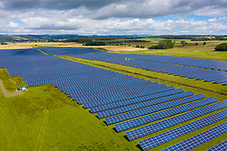 Aerial view of Errol solar farm near Perth in Scotland, UK. Operated by Elgin Energy it is largest solar farm in Scotland generating 13MW from 55,000 solar panels.
