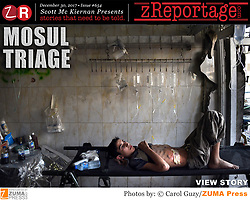 zReportage.com Story of the Week # 654 -  Mosul Triage - Launched Dec. 30, 2017 - Full multimedia experience: audio, stills, text and or video: Go to zReportage.com to see more - A glimpse into the faces and moments of those affected by the fierce conflict with ISIS in Mosul. Wounded and weak, most who survived now face an uncertain future in the limbo of IDP camps. Shattered lives, lost loved ones and escape from the rubble of collapsed homes and the evil of ISIS doctrine, leaves scars of emotional trauma even more difficult to heal. The war in Mosul is over, but the humanitarian crisis continues. (Credit Image: ? Carol Guzy/zReportage.com via ZUMA Wire)