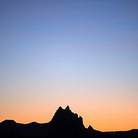 The sun sets on the Shiprock Pinnacle in Shiprock Tuesday.