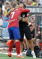Atletico de Madrid's Antoine Griezmann celebrates goal with the Physical trainer Oscar 'El Profe' Ortega during La Liga match.September 22,2015. (ALTERPHOTOS/Acero)