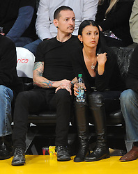 ©2011 GAMEPIKS 310-828-3445<br /> <br /> Linkin Park lead singer Chester Bennington and his wife Talinda Bentley sits courtside as he attends the Los Angeles Lakers/Portland Trail Blazers NBA game at Staples Center in Los Angeles on March 20, 2011. The Lakers defeated the Blazers 84-80.<br /> <br /> XYZ (Mega Agency TagID: MEGAR32159_3.jpg) [Photo via Mega Agency]