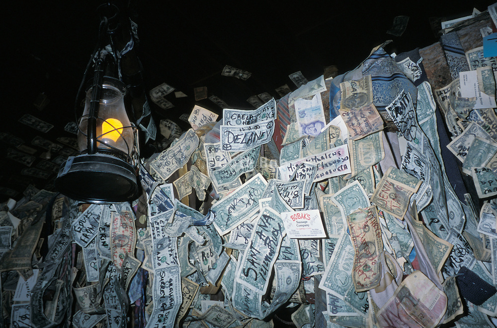 American money hanging from ceiling in a bar