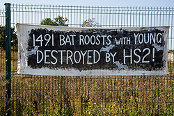 A banner regarding bat roosts is displayed on a fence by environmental activists from HS2 Rebellion who blocked two gates to the South Portal site for the HS2 high-speed rail link on 14 September 2020 in West Hyde, United Kingdom.
