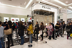 © Licensed to London News Pictures. 26/12/2016. Customers queuing for ladies Prada handbags in Selfridges store in Oxford Street for the start of the stores Boxing Day sales. London, UK. Photo credit: Ray Tang/LNP