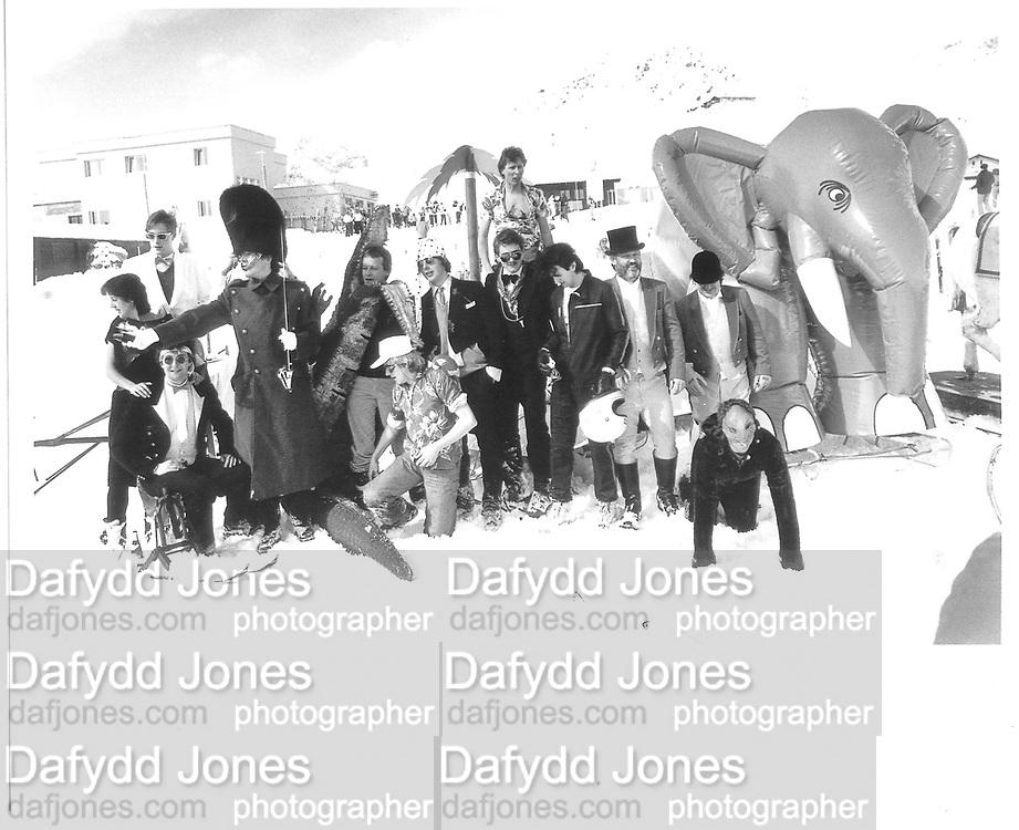 ?Tim Hunt, ?Jerome Fack, Tommy Leigh-Pemberton, Steve Smithwick, Tommy Leigh-Pemberton, Mike Fitzroy, ~Peter Carew, Martin Lyster, Lord Xan rufus-Isaacs, David Kirke, Cosmo Hulton, The Dangerous Sports Club group photo. D.S.C Ski Race  St. Moritz 1983© Copyright Photograph by Dafydd Jones 66 Stockwell Park Rd. London SW9 0DA Tel 020 7733 0108 www.dafjones.com