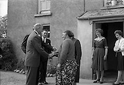 18/05/1961<br /> 05/18/1961<br /> 18 May 1961<br /> U.S. Ambassador Edward Grant Stockdale visits relatives of President John F. Kennedy at Dunganstown, Co. Wexford. Ambassador Stockdale greeted by Mary Ryan.