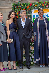 George and Amal Clooney, representing the Clooney Foundation for Justice, arrive at the People's Postcode Lottery charity gala at McEwan Hall, Bristo Square. Pic with women's rights campaigner Nice Nailantei Leng'ete.