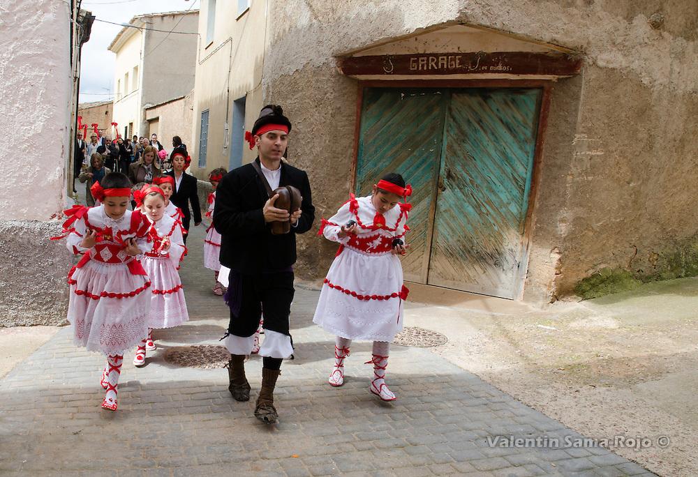 'Danzantes' wearing red dresses honoring saint San Juan Lorenzo during the procession of San Juan Lorenzo festivities in Cetina.
