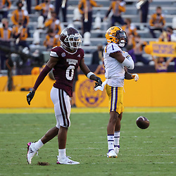 Sep 26, 2020; Baton Rouge, Louisiana, USA; LSU Tigers cornerback Eli Ricks (1) celebrates after he intercepts a pass over Mississippi State Bulldogs wide receiver JaVonta Payton (0) during the second half at Tiger Stadium. Mandatory Credit: Derick E. Hingle-USA TODAY Sports