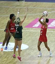 England Vitality Roses Serena Guthrie (right) and South Africa Spar Proteas Erin Burger (centre) battle for the ball during the Vitality Netball International Series match at The Copper Box, London.
