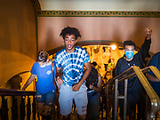 12 JUNE 2020 - DES MOINES, IOWA: CHARLES, (first name only) left, and MATTHEW BRUCE lead a group of Black Lives Matter protesters through the Iowa capitol. About 75 activists from Black Lives Matter came to the Iowa State Capitol in Des Moines Friday to talk to Iowa Governor Kim Reynolds. They've been trying to meet with Gov. Reynolds all week. She made time for them Friday and met with 5 representatives of the organization without any media in the room. They wanted to talk to her about police violence against African-Americans and racial disparities in Iowa's justice system. While the 5 met with the Governor, the remaining activists picketed the hall in front of her office and chanted.    PHOTO BY JACK KURTZ