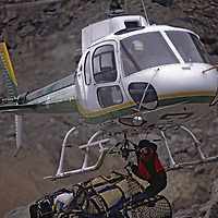 BAFFIN ISLAND, Nunavut, Canada. Helicopter retrieves equipment after Great Sail Peak big wall climbing expedition.