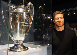 14.10.2014, Allianz Arena, München, GER, 1. FBL, FC Bayern Muenchen, Xabi Alonso, im Bild Xabi Alonso (FC Bayern München) neben dem Champions League Pokal // FC Bayern Munich player Xabi Alonso visits the FC Bayern Erlebniswelt Museum at the Allianz Arena in München, Germany on 2014/10/14. EXPA Pictures © 2014, PhotoCredit: EXPA/ Eibner-Pressefoto/ FCB/Getty Pool<br /> <br /> *****ATTENTION - OUT of GER*****