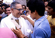 The martyr Archbishop Oscar Romero of El Salvador is greeted by several hundred of the faithful after a mass at Iglesia el Rosario -the Church of the Rosary - in San Salvador, El Salvador. The priest was later slain at the alter by a right wing gunman in 1980. Óscar Arnulfo Romero y Galdámez was a bishop of the Catholic Church in El Salvador. He became the fourth Archbishop of San Salvador, succeeding Luis Chávez, and spoke out against poverty, social injustice, assassinations and torture. Romero was assassinated while offering Mass on March 24,1980. To license this image, click on the shopping cart below -