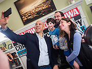 31 DECEMBER 2019 - ANKENY, IOWA: US Senator CORY BOOKER (D-NJ) takes a selfie with a family after he made a speech at a campaign house party in Ankeny, a suburb of Des Moines. Sen Booker is campaigning in Iowa over New Years to support his candidacy for the US Presidency. Iowa traditionally holds the first event of the presidential election cycle. The Iowa caucuses are Feb. 3, 2020.       PHOTO BY JACK KURTZ