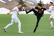 Jackson's Kevin Cisneros (20) kicks the ball away from Star Valley's Bryson Jenkins (10) during Jackson's 5-2 win against Star Valley at Jackson Hole High School in Jackson, Wyoming on Thursday, April 11, 2019. (Rebecca Noble/Jackson Hole News&Guide)