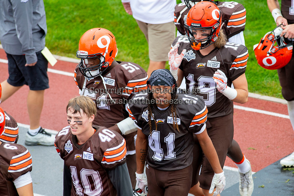 KELOWNA, BC - SEPTEMBER 8:   Liam Johnstone #40, Nate Adams #41, Jordan Robinson #51 and Cole Stregger #19 of Okanagan Sun head to the dressing room at half time against the Langley Rams at the Apple Bowl on September 8, 2019 in Kelowna, Canada. (Photo by Marissa Baecker/Shoot the Breeze)
