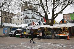 Empty Gentleman's Walk next to Norwich Market during Coronavirus lockdown 3 on the day it snowed, UK January 2021