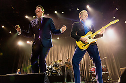 © Licensed to London News Pictures. 17/03/2015. London, UK.   Spandau Ballet performing live at The O2 Arena.   In this picture - Tony Hadley (left), Gary Kemp (right). Spandau Ballet are a British new wave band formed in London in the late 1970s, composed of members Tony Hadley (lead vocals, synthesisers), Gary Kemp ( guitar, keyboards, backing vocals), Steve Norman (saxophone, guitar, percussion), John Keeble –(drums, backing vocals), <br /> Martin Kemp (bass).  Photo credit : Richard Isaac/LNP