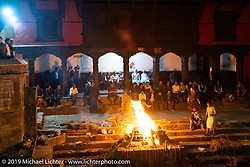 Open air cremations around Pashupatinath Temple in Kathmandu before leaving on Motorcycle Sherpa's Ride to the Heavens motorcycle adventure in the Himalayas of Nepal. Sunday, November 3, 2019. Photography ©2019 Michael Lichter.