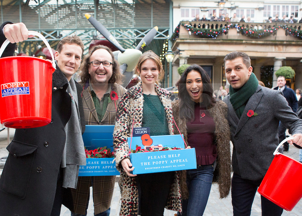 © Licensed to London News Pictures. 07/11/2013.  Strictly Come Dancing from left to right - Brendan Cole, Dave Myers,  Sophie Ellis Bexter, Karen Hauer and Pasha Kovolev were out today collecting for the Poppy Appeal in Covent Garden as part of London Poppy Day.  The dance stars joined service personnel to help the charity raise one million pounds in the capital today.  Photo credit: Alison Baskerville/LNP