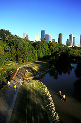 Stock photo of an aerial view of two people canoeing in Buffalo Bayou near downtown Houston