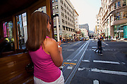 Riding the famous cable cars in San Francisco, CA (model released)