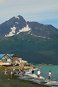 Fishing during the Seward Salmon Derby with the mountains of Chugach National Forest as a background, Lowell Point, Resurrection Bay, Seward, Alaska.