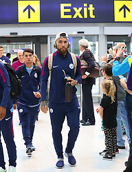 Nikolas Otamendi as the Manchester City team arrive at Manchester Airport as they jet for Iceland