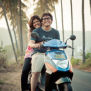 A young Indian couple on a scooter in Goa