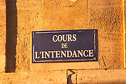 The Cours de L'Intendence shopping street in Bordeaux - street sign in evening sunlight