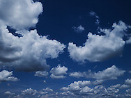 A vibrant blue sky filled with small white clouds over Dong Hoi, Quang Binh Province, Vietnam, Southeast Asia