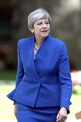 Prime Minister Theresa May, arrives to make a statement in Downing Street after she traveled to Buckingham Palace for an audience with Queen Elizabeth II following the General Election results.