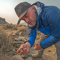 Archaeologists Micah Hale investigates artifacts at an early Native American settlement in the White Mountains of California,