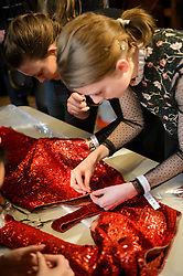 Seamstresses adjust clothes backstage before the Julien Macdonald Autumn/Winter 2017 London Fashion Week show at Goldsmith's Hall, London.PRESS ASSOCIATION Photo. Picture date: Saturday February 18th, 2017. Photo credit should read: Matt Crossick/PA Wire.