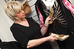 Manager checking donated goods at a Mysight charity shop.