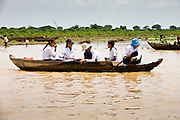 18 MARCH 2006 - SIEM REAP, SIEM REAP, CAMBODIA:  School children paddle back to their homes in the Tonle Sap Lake after school in Chong Kneas, near Siem Reap, Cambodia. Chong Kneas is a floating community in the giant Tonle Sap Lake.  Photo by Jack Kurtz