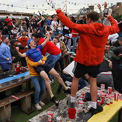 © Licensed to London News Pictures. 29/06/2021. London, UK. England fans react to going 2-0 up during the Euro 2020 round of 16 game between England and Germany at the Skylight Rooftop bar in Tobacco Dock, east London. Photo credit: Ben Cawthra/LNP