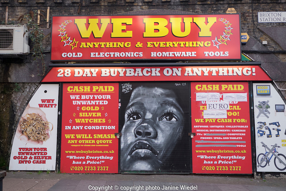 Mural by Furia139 on We Buy Pawn shop in Railway arches in Station Road Brixton South London