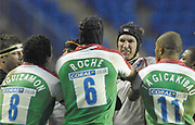 Reading, GREAT BRITAIN,    London Irish player confront,  Justin HARRISON  about an disagreement  of the ball , during the third round Heineken Cup game, London Irish vs Ulster Rugby, at the Madejski Stadium, Reading ENGLAND, Sat 09.12.2006. [Photo Peter Spurrier/Intersport Images]