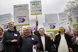 """© licensed to London News Pictures. London, UK 15/05/2013. Around 300 nuns, priests, monks and """"Enough food for everyone IF campaign"""" supporters marching to Houses of Parliament in London to protest global hunger and lobby their MPs. Photo credit: Tolga Akmen/LNP"""