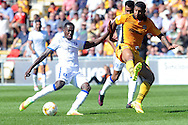 Mansfield's Mitchell Rose (l) shoots at goal challenged by Newport's Joss Labadie. Skybet EFL league two match, Newport county v Mansfield Town at Rodney Parade in Newport, South Wales on Saturday 6th August 2016.<br /> pic by Carl Robertson, Andrew Orchard sports photography.