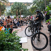 Demonstrators kneel as they ask the Orlando Police Department to join them during a protest at Orlando City Hall on Wednesday, June 3, 2020, in Orlando, Fla., over the death of George Floyd. Floyd died after being restrained by Minneapolis police officers on May 25.  (Alex Menendez via AP)